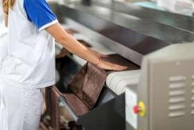 Woman ironing of machines